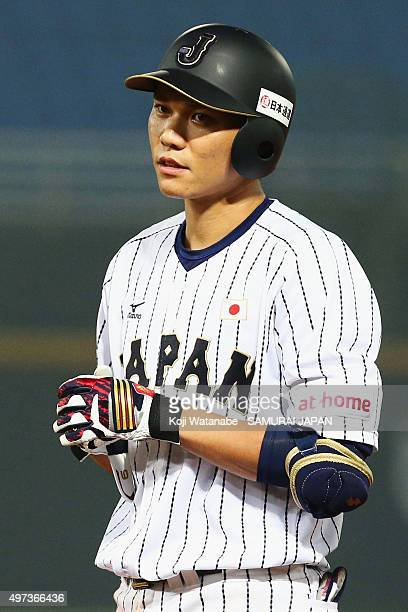 Hayato Sakamoto of Japan reacts after hitting a RBI single in the bottom of sixth inning during the WBSC Premier 12 quarter final match between Japan...