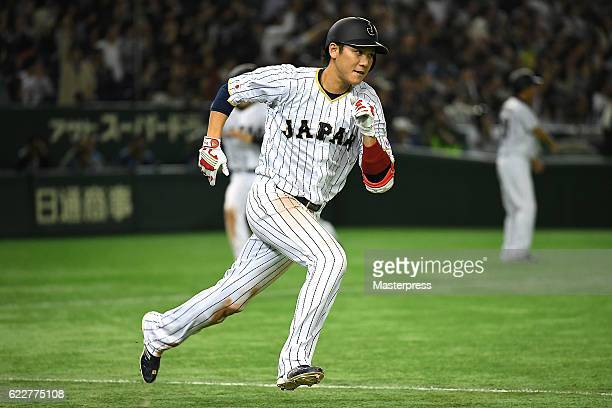 Hayato Sakamoto of Japan runs after hitting a threerun double in the fifth inning during the international friendly match between Japan and...