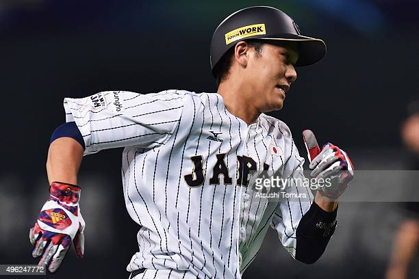 Hayato Sakamoto of Japan runs to the home by RBI double of Tetsuto Yamada in the bottom of the eighth inning during the WBSC Premier 12 match between...