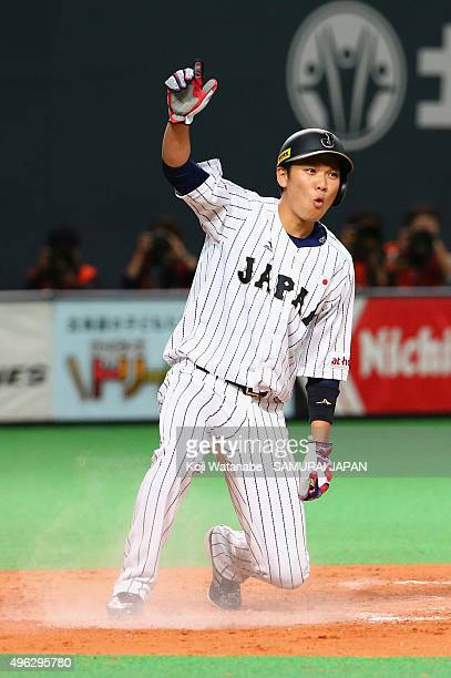 Hayato Sakamoto of Japan slides safely in the home by RBI double of Tetsuto Yamada in the bottom of the eighth inning during the WBSC Premier 12...