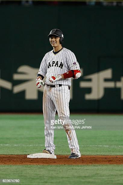 Hayato Sakamoto of Japan smiles after hitting a threerun double in the fifth inning during the international friendly match between Japan and...
