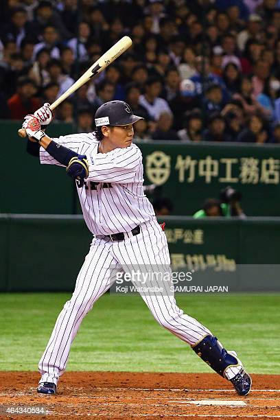 Hayato Sakamoto of Samurai Japan bats during the game three of Samurai Japan and MLB All Stars at Tokyo Dome on November 15 2014 in Tokyo Japan