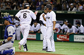 Hayato Sakamoto of Samurai Japan celebrates after hitging tworun homer in the second inning during the game three of Samurai Japan and MLB All Stars...