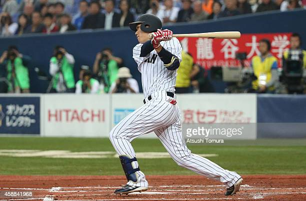 Hayato Sakamoto of Samurai Japan hits a double in second inning during the Game one of Samurai Japan and MLB All Stars at Kyocera Dome Osaka on...