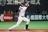 Hayato Sakamoto of Samurai Japan hits a single in the first inning during the game five of Samurai Japan and MLB All Stars at Sapporo Dome on...