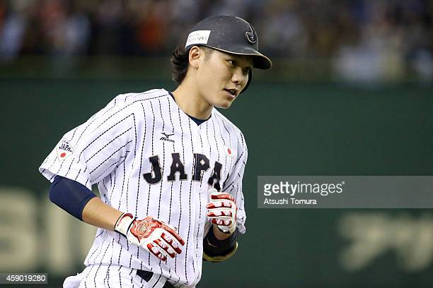 Hayato Sakamoto of Samurai Japan hits tworun homer in the second inning during the game three of Samurai Japan and MLB All Stars at Tokyo Dome on...