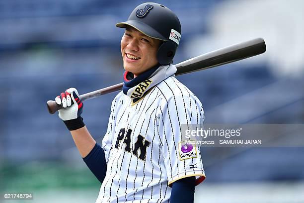 Hayato Sakamoto of SAMURAI JAPAN smiles during the Japan national baseball team practice session at the QVC on November 8 2016 in Tokyo Japan