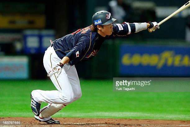 Hayato Sakamoto of Team Japan bats during the 2013 World Baseball Classic exhibition game against the Yomiuri Giants at the Fukuoka Yahoo Japan Dome...