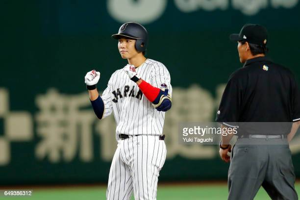 Hayato Sakamoto of Team Japan reacts to hitting an RBI double in fifth inning during the Game 1 of Pool B against Team Cuba at the Tokyo Dome on...