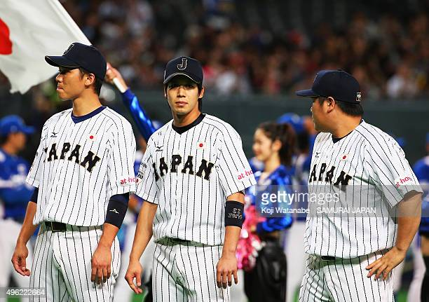 Hayato Sakamoto Tetsuto Yamada and Takeya Nakamura of Japan line up prior to the WBSC Premier 12 match between Japan and South Korea at the Sapporo...