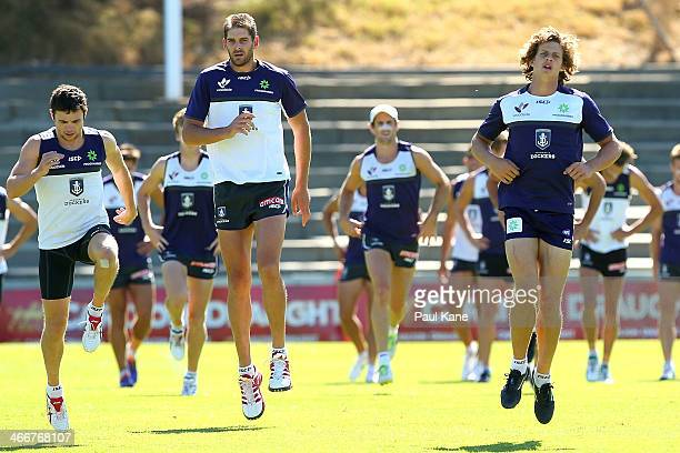 Hayden Ballantyne Aaron Sandilands and Nathan Fyfe warm up during a Fremantle Dockers AFL preseason training session at Fremantle Oval on February 4...
