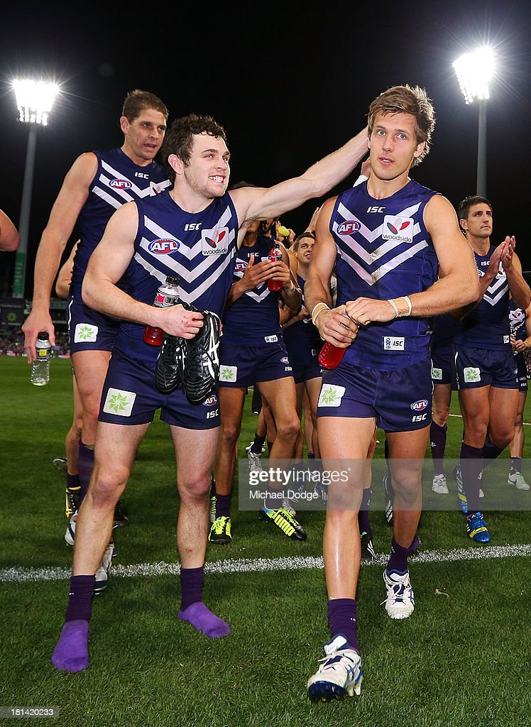 Hayden Ballantyne and Matt De Boer (R) who played his 100th game of the Dockers celebrate their win during the AFL Second Preliminary Final match between the Fremantle Dockers and the Sydney Swans at Patersons Stadium on September 21, 2013 in Perth, Australia.