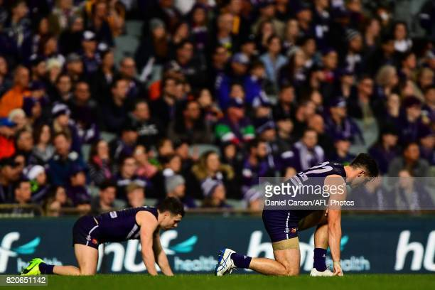 Hayden Ballantyne and Shane Kersten of the Dockers pick themselves up after a hard contest during the 2017 AFL round 18 match between the Fremantle...