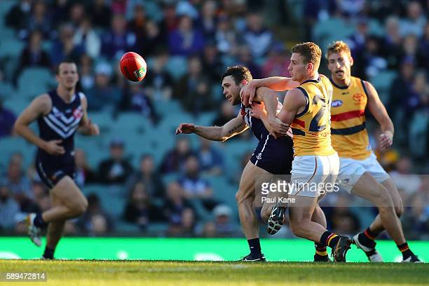 Hayden Ballantyne of the Dockers and Rory Laird of the Crows contest for the ball during the round 21 AFL match between the Fremantle Dockers and the...