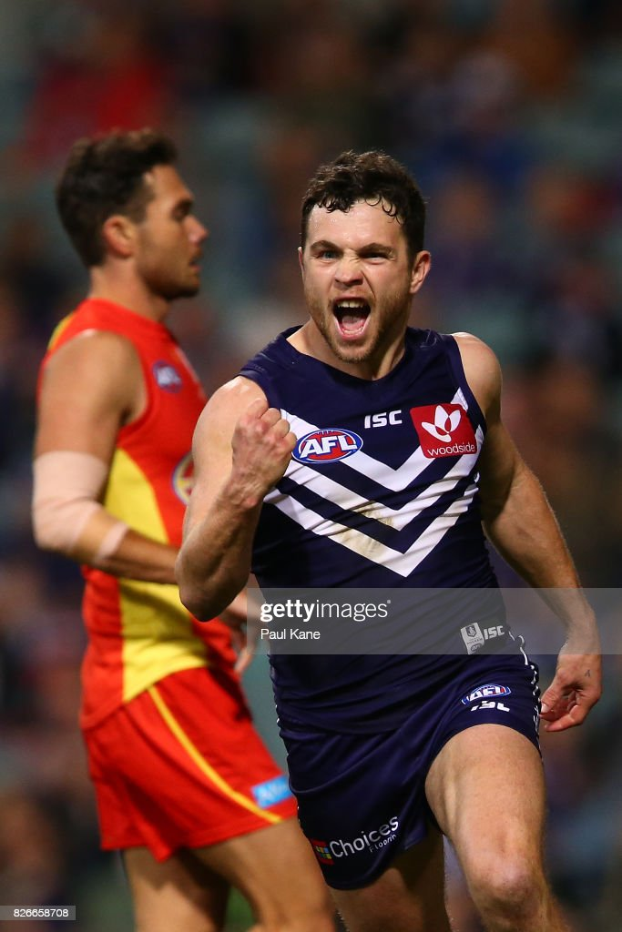 Hayden Ballantyne of the Dockers celebrates a goal during the round 20 AFL match between the Fremantle Dockers and the Gold Coast Suns at Domain Stadium on August 5, 2017 in Perth, Australia.