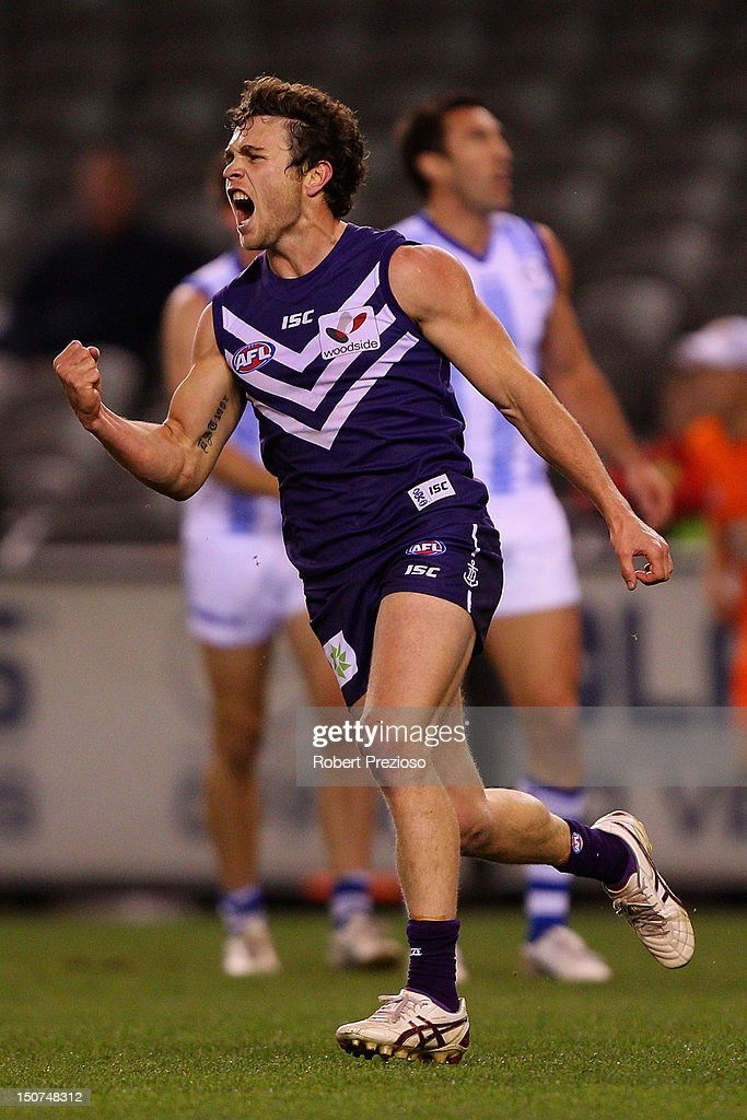 Hayden Ballantyne of the Dockers celebrates kicking a goal during the round 22 AFL match between the North Melbourne Kangaroos and the Fremantle Dockers at Etihad Stadium on August 26, 2012 in Melbourne, Australia.