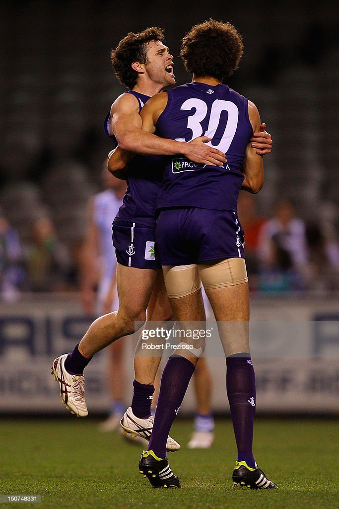 Hayden Ballantyne of the Dockers celebrates kicking a goal with team-mate Zac Clarke of the Dockers during the round 22 AFL match between the North Melbourne Kangaroos and the Fremantle Dockers at Etihad Stadium on August 26, 2012 in Melbourne, Australia.