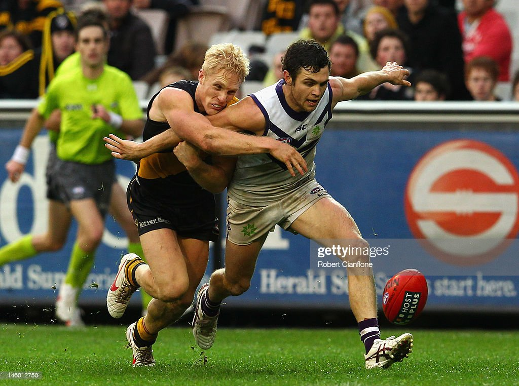 Hayden Ballantyne of the Dockers kicks the ball off the ground to score a goaal during the round 11 AFL match between the Richmond Tigers and the Fremantle Dockers at Melbourne Cricket Ground on June 9, 2012 in Melbourne, Australia.