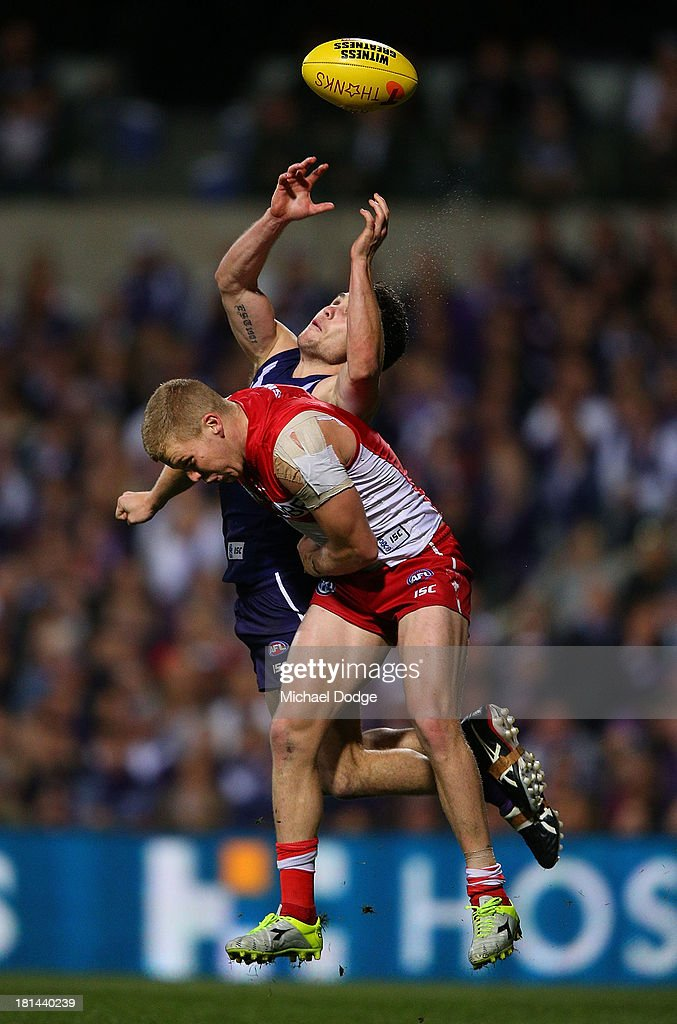 Hayden Ballantyne of the Dockers marks the ball against Daniel Hannebery of the Swans during the AFL Second Preliminary Final match between the Fremantle Dockers and the Sydney Swans at Patersons Stadium on September 21, 2013 in Perth, Australia.