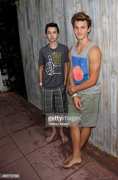 Hayden Byerly and Gavin MacIntosh attend the Hollister House summer concert series at Hollister House on July 25 2014 in Santa Monica California
