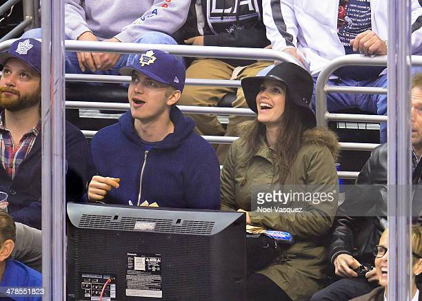 Hayden Christensen and Rachel Bilson attend a hockey game between the Toronto Maple Leafs and the Los Angeles Kings at Staples Center on March 13...