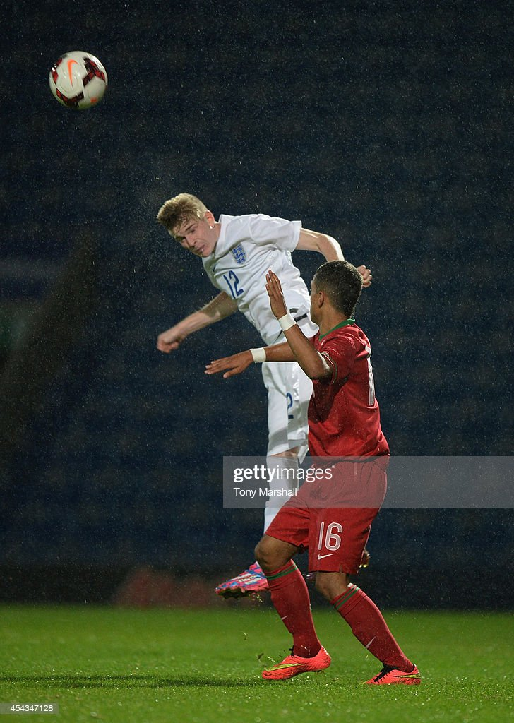 Hayden Coulson of England is challenged by Centeno of Portugal during the Under 17 International match between England U17 and Portugal U17 at Proact Stadium on August 29, 2014 in Chesterfield, England.