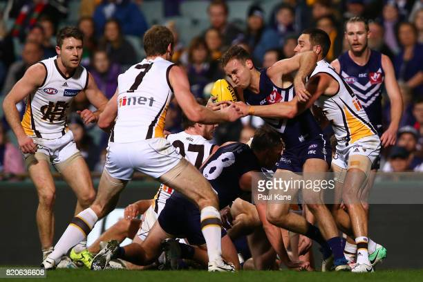 Hayden Crozier of the Dockers attempts to clear the ball during the round 18 AFL match between the Fremantle Dockers and the Hawthorn Hawks at Domain...