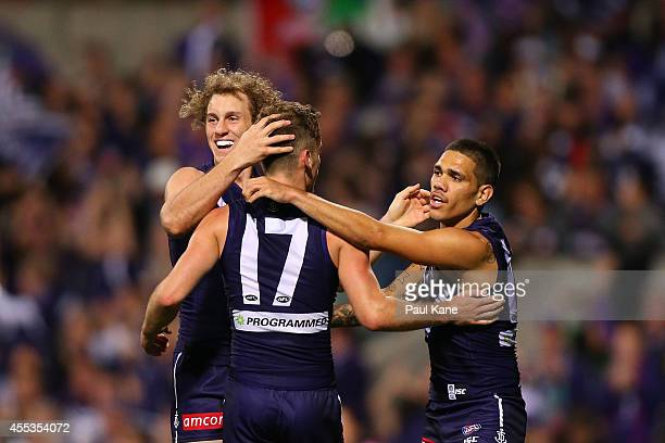 Hayden Crozier of the Dockers is congratulated by Chris Mayne and Michael Walters after kicking a goal during the AFL 1st Semi Final match between...