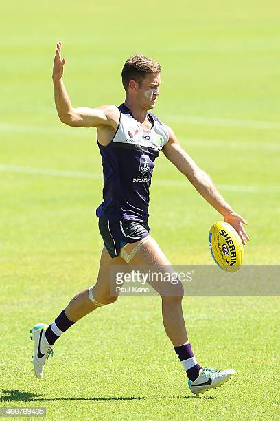 Hayden Crozier passes the ball during a Fremantle Dockers AFL preseason training session at Fremantle Oval on February 4 2014 in Fremantle Australia