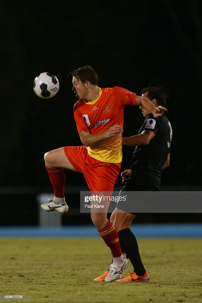 Hayden Doyle of the Lions and Shane Steffanutto of the Roar contest for the ball during the FFA Cup match between the Stirling Lions and the Brisbane Roar at Western Australia Athletics Stadium on August 19, 2014 in Perth, Australia.