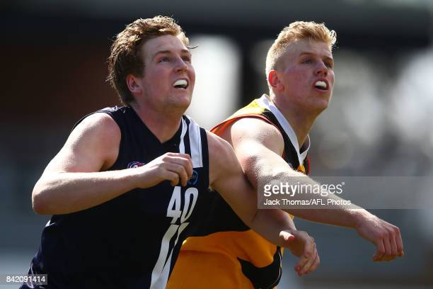 Hayden Elliot of the Geelong Falcons and Riley D'arcy of the Dandenong Stingrays during the TAC Cup round 18 match between Geelong and Dandenong at...