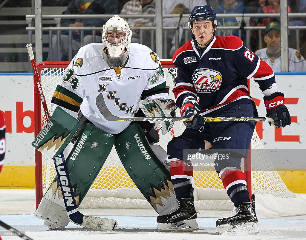 Hayden Hodgson #29 of the Saginaw Spirit looks for a shot to tip in front of Tyler Johnson #34 of the London Knights during an OHL game at Budweiser Gardens on October 21, 2016 in London, Ontario, Canada. The Knights defeated the Spirit 5-1.