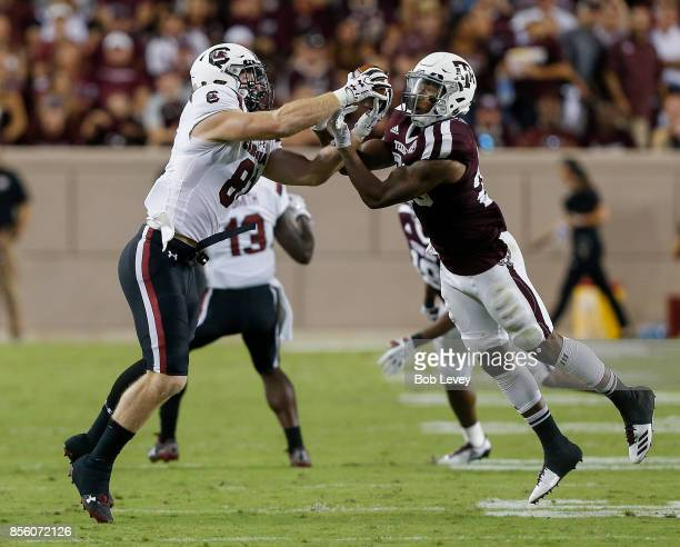 Hayden Hurst of the South Carolina Gamecocks takes the ball away from Armani Watts of the Texas AM Aggies for a reception at Kyle Field on September...