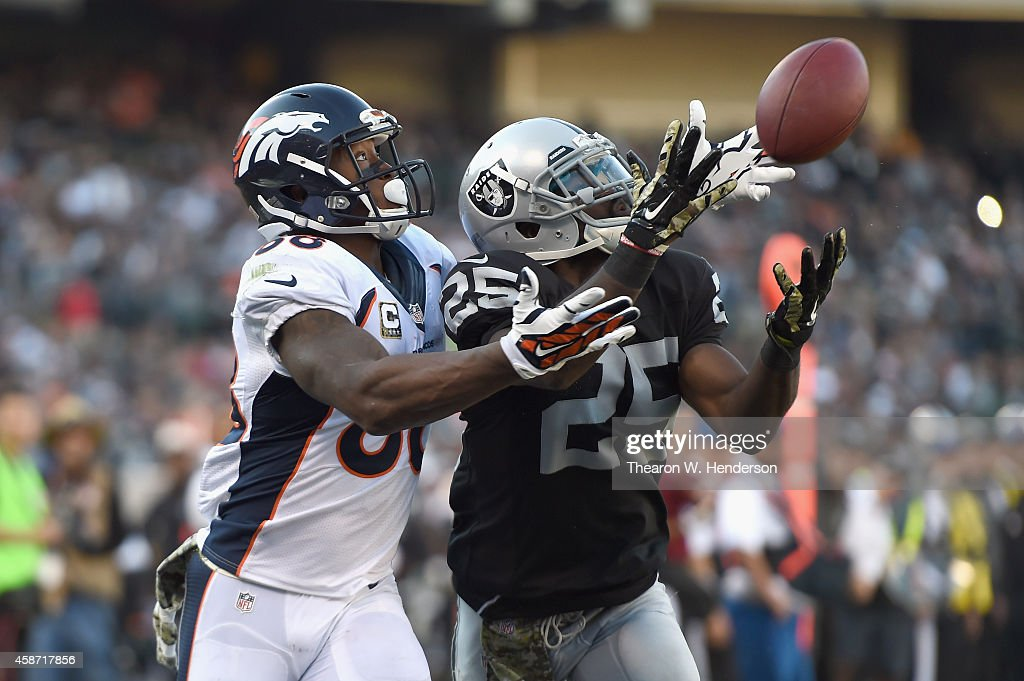 J Hayden of the Oakland Raiders cannot complete the reception against the defense of Demaryius Thomas of the Denver Broncos in the third quarter at...