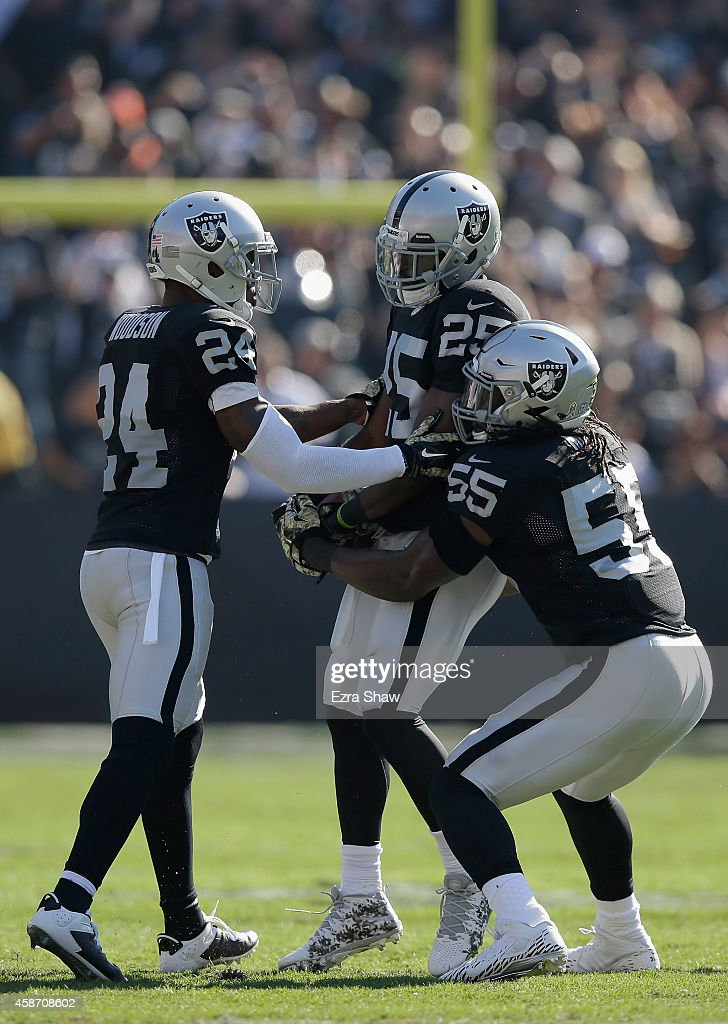 J Hayden of the Oakland Raiders Charles Woodson of the Oakland Raiders and Sio Moore of the Oakland Raiders celebrate an interception in the first...