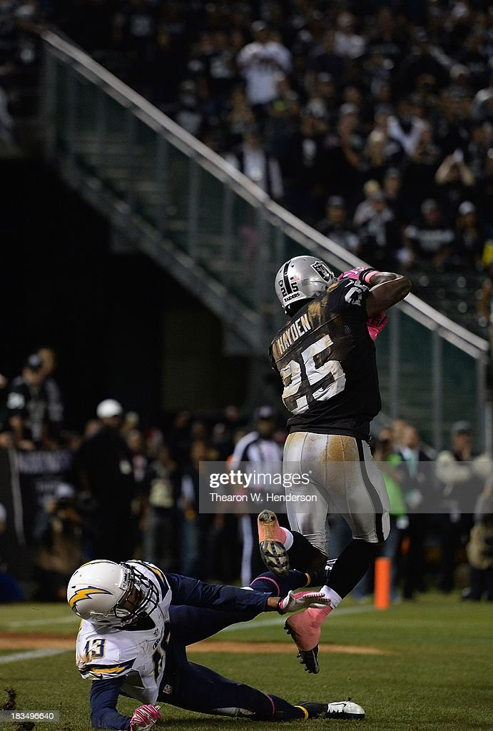 Hayden of the Oakland Raiders intercepts a pass in the endzone intended for Keenan Allen of the San Diego Chargers late in the fourth quarter at Oco...
