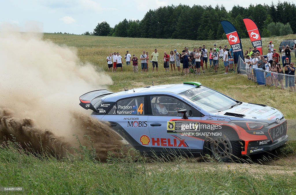 Hayden Paddon and co-driver John Kennard from New Zealand, drive their Hyundai N i20 WRC during the special stage of The Rally of Poland in Stare Juchy, Poland on July 1, 2016. / AFP / JANEK
