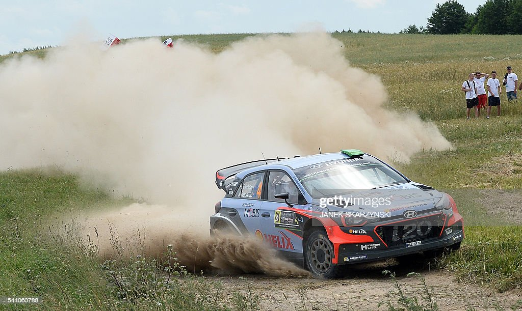 Hayden Paddon and co-driver John Kennard from New Zealand, drive their Hyundai N i20 WRC during the special stage at Rally Poland, in Stare Juchy, Poland, on July 1, 2016. / AFP / JANEK