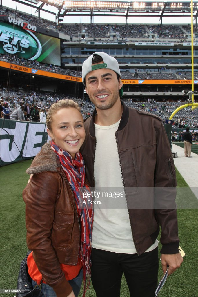 Hayden Pannittiere and Scotty McKnight attend the football game between the Jets and the Colts at the MetLife Stadium on October 14, 2012 in East Rutherford, New Jersey.