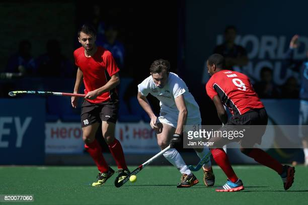 Hayden Phillips of New Zealand attempts to get past Amr Sayed of Egypt during the 5th8th place play off match between Egypt and New Zealand on Day 7...