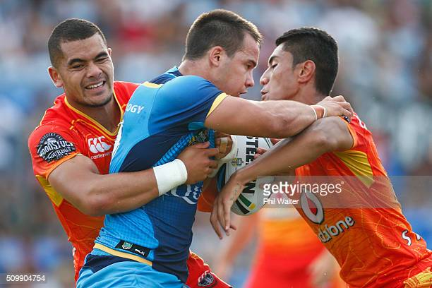 Hayden Schwass of the Titans is tackled during the NRL Trial Match between the New Zealand Warriors and the Gold Coast Titans at Toll Stadium on...