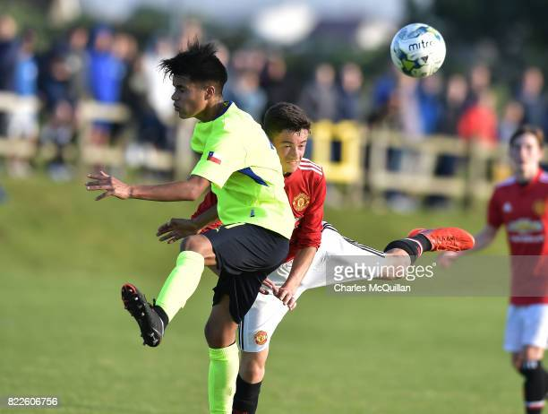 Hayden Smethurst of Manchester United and Miguel Montecinos of Colina during the NI Super Cup junior section game between Manchester United and...