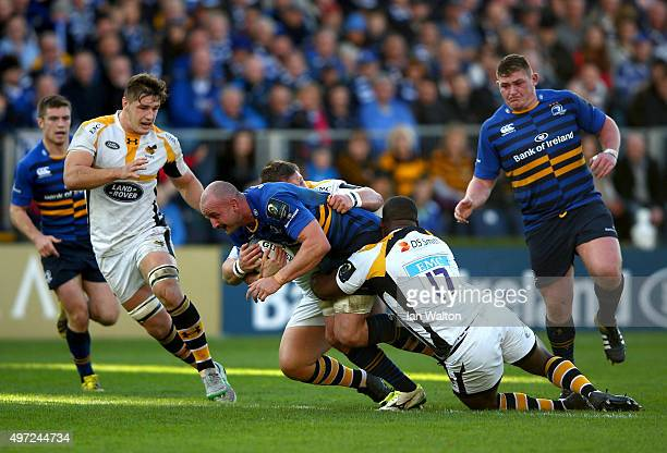 Hayden Triggs of Leinster is tackled by Simon McIntyre of Wasps during the European Rugby Champions Cup match between Leinster Rugby and Wasps at the...