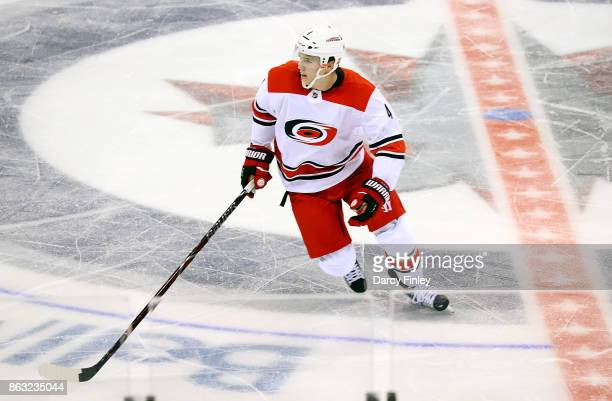 Haydn Fleury of the Carolina Hurricanes keeps an eye on the play during second period action against the Winnipeg Jets at the Bell MTS Place on...
