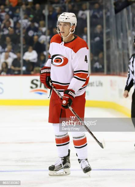 Haydn Fleury of the Carolina Hurricanes keeps an eye on the play during third period action against the Winnipeg Jets at the Bell MTS Place on...
