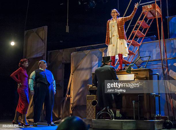 Haydn Gwynne as Mrs Peacham Nick Holder as Mr Peachum Rosalie Craig as Polly Peachum perform on stage in a performance of The Threepenny Opera at The...