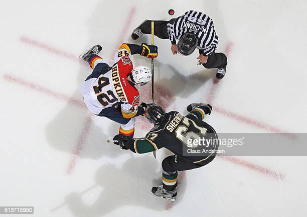 Haydn Hopkins of the Erie Otters takes a faceoff against Kole Sherwood of the London Knights during an OHL game at Budweiser Gardens on March 3 2016...