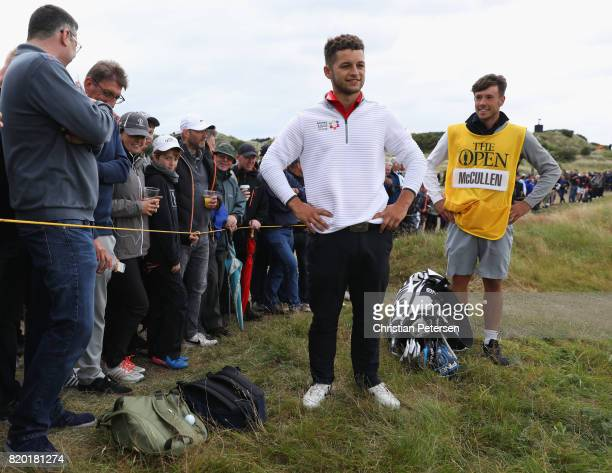 Haydn McCullen of England waits for a rules official as his ball lands on the bag of a spectator during the second round of the 146th Open...