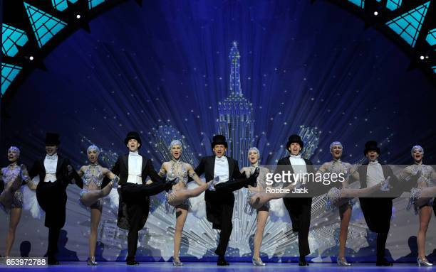 Haydn Oakley as Henri Baurel with artists of the company in An American in Paris choreographed and directed by Christopher Wheeldon at The Dominion...