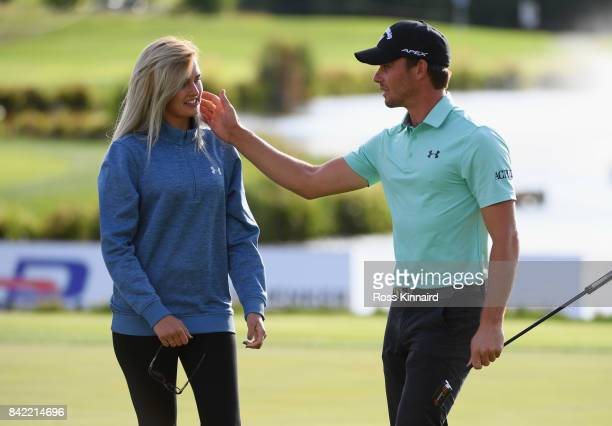 Haydn Porteous of South Africa celebrates victory with girlfriend Daniela Vagnerova after the final round on day four of the DD REAL Czech Masters at...